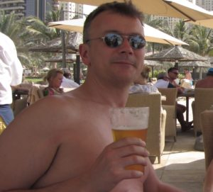 Man can't stop drinking, on holiday with beer in hand