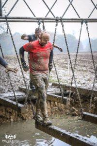 man running in mud
