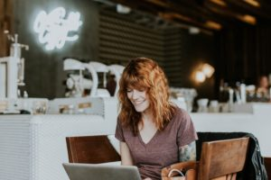 woman on laptop speaking with online community