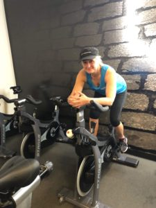 woman quits alcohol on exercise bike