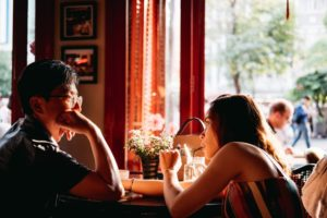 sober dating, couple sat together at table