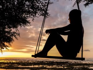 woman on hammock visualising success